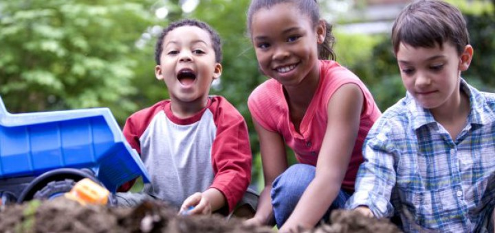 Two boys and one girl visibly happy playing along